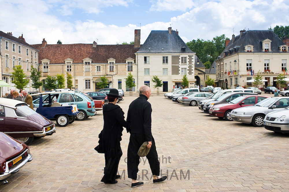 Couple in Central square in town of Richelieu in Loire Valley, Indre et Loire, France