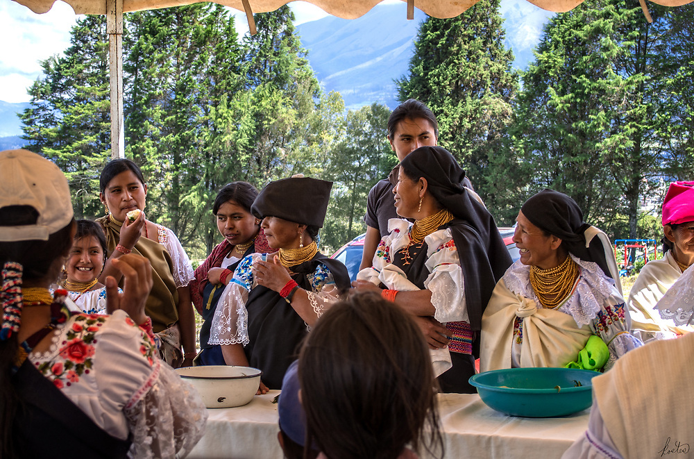 A group of Kichwa women serving food at Kapak Raymi ceremony in Cotacachi, Ecuador