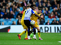 Lincoln City's Chris Maguire battles with Sheffield Wednesday's Fisayo Dele-Bashiru<br /> <br /> Photographer Andrew Vaughan/CameraSport<br /> <br /> The EFL Sky Bet League One - Sheffield Wednesday v Lincoln City - Saturday 23rd October 2021 - Hillsborough Stadium - Sheffield<br /> <br /> World Copyright © 2021 CameraSport. All rights reserved. 43 Linden Ave. Countesthorpe. Leicester. England. LE8 5PG - Tel: +44 (0) 116 277 4147 - admin@camerasport.com - www.camerasport.com