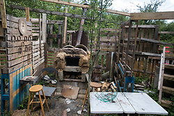 Wendover, UK. 17 July, 2020. A home-built pizza oven constructed by environmental activists at Wendover Active Resistance Camp. Activist groups including Stop HS2 and HS2 Rebellion continue to oppose HS2, which is currently projected to cost £106bn and which will remain a net contributor to CO2 emissions during its projected 120-year lifespan, on environmental and economic grounds.