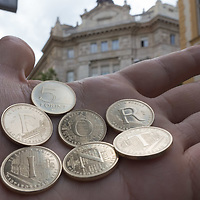 75th anniversary commemorative coin set displaying the text Forint name of the Hungary currency is seen in front of the building of the National Bank that appears on the design of the coins in Budapest, Hungary on Aug. 6, 2021. ATTILA VOLGYI