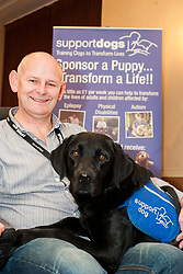 John Newcombe and his support dog Blue who graduated at the Support Dogs 8th Annual Graduation Awards Ceremony held at Tankersley Manor on Sunday<br /> <br /> 24 November 2013<br /> Image © Paul David Drabble<br /> www.pauldaviddrabble.co.uk