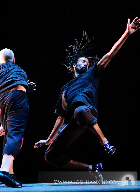 """""""Tap Out Loud"""" by Chicago Dance Theatre, a dance production done in collaboration with other dance and musical performers at Chicago's Athenaeum Theater...Dancer: Richard Ashworth punches Phil Brooks..Thug Life .Choreography:Kyle Vincent Terry and Mark Yonally .Music: Bonobo, RJD2 .Costume Design: Anna Glowacki .Dancers:Richard Ashworth, Martin Bronson, Phil Brooks, .Jenna Deidel, Kendra Jorstad, Stacy Milam, Jennifer Pfaff,  .Mark Yonally  ."""