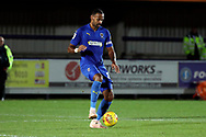 AFC Wimbledon midfielder Liam Trotter (14) dribbling during the EFL Trophy group stage match between AFC Wimbledon and Stevenage at the Cherry Red Records Stadium, Kingston, England on 6 November 2018.