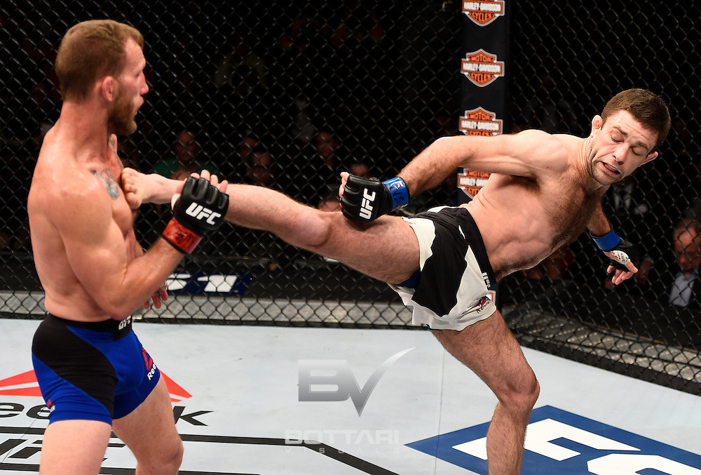 LAS VEGAS, NV - DECEMBER 03:  (R-L) Ryan Hall kicks Gray Maynard in their featherweight bout during The Ultimate Fighter Finale event inside the Pearl concert theater at the Palms Resort & Casino on December 3, 2016 in Las Vegas, Nevada. (Photo by Jeff Bottari/Zuffa LLC/Zuffa LLC via Getty Images)