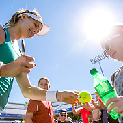 August 22, 2016, New Haven, Connecticut: <br /> Eugenie Bouchard of Canada signs autographs following a match on Day 4 of the 2016 Connecticut Open at the Yale University Tennis Center on Monday August  22, 2016 in New Haven, Connecticut. <br /> (Photo by Billie Weiss/Connecticut Open)