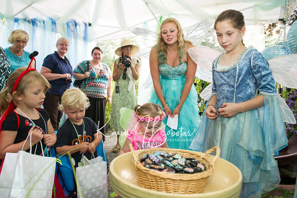 Guilla and Wogan VanEtten and Rori Stohl visit the Waterfall Fairies at their magic stone garden during Cackleberries Fairy Night Wednesday evening.   (Karen Bobotas/for the Laconia Daily Sun)