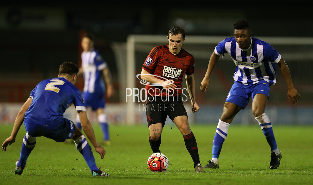 Joe Ward, West Bromwich Albion striker gets between Rohan Ince, Brighton midfielder and Rob Hunt, Brighton defender during the Barclays U21 Premier League match between Brighton U21 and U21 West Bromwich Albion at the Checkatrade.com Stadium, Crawley, England on 25 January 2016.