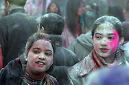 Indians celebrate the Spring holiday of Holi, by throwing colored powders and spraying colored water on each other to chase away the gray of winter.  The festival took place on Liberty Ave, and most of the powder was thrown in Smoky Oval Park in Richmond Hill Queens..Photo by Nancy Siesel