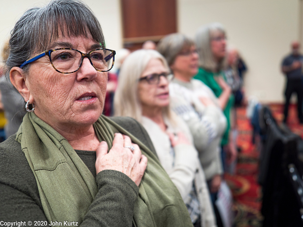 16 JANUARY 2020 - DES MOINES, IOWA: Women recite the Pledge of Allegiance at the Women for Trump rally in Airport Holiday Inn in Des Moines. About 200 women attended the event, which featured Lara Trump, Mercedes Schlapp, and Kayleigh McEnany, surrogates on the campaign trail for President Donald Trump.         PHOTO BY JACK KURTZ