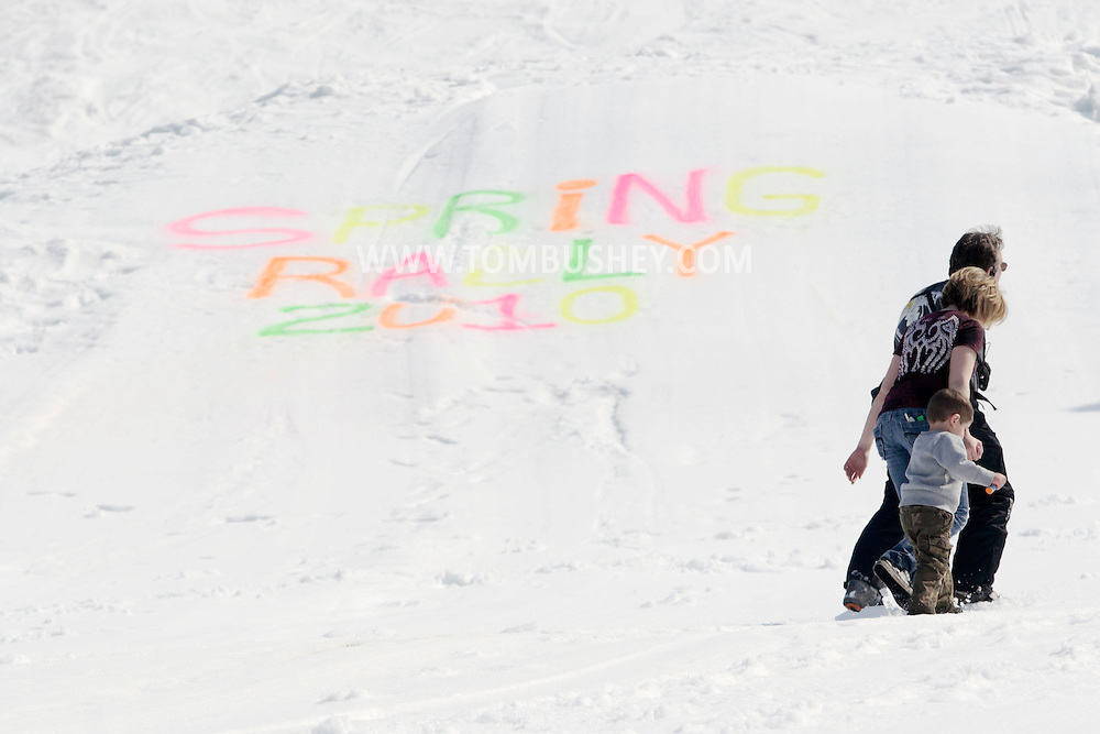 Warwick, New York - People walk up the slope before the start of the Big Air event during the annual Spring Rally at Mount Peter Ski and Ride on March 21, 2010.
