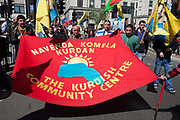 Demonstration by unions and other organisations of workers to mark the annual May Day or Labour Day. Groups from all nationalities from around the World, living in London gathered to march to a rally in central London, UK.