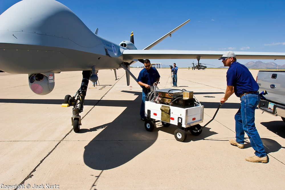 29 SEPTEMBER 2005 - SIERRA VISTA, AZ: Contract workers at Ft. Huachuca, a US Army base in Sierra Vista, service  a Predator, an Unmanned Aerial Vehicle, used by the Border Patrol for surveillance along the Arizona stretch of the US/Mexico border. The aircraft are flown along the US Mexico border by US Border Patrol agents based in Texas and Arizona.  The U.S. Customs and Border Protection (CBP) agency flies thePredator drones at an altitude of 15,000 feet for policing immigration, drug smugglers and terrorists along the U.S.-Mexico border.    PHOTO BY JACK KURTZ