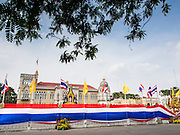 14 DECEMBER 2013 - BANGKOK, THAILAND: Anti-government protestors have wrapped the Government House, the office of the Thai Prime Minister, in a Thai flag. The Thai anti-government movement, called the People's Democratic Reform Committee (PRDC) sponsored a forum Saturday to establish guidelines for political reform in Thailand. The opposition leader, Suther Thaugsuban, said his movement will not participate in a similar forum, sponsored by the government scheduled for Sunday. Thailand's political impasse continues with the opposition calling for the caretaker government of Prime Minister Yingluck Shinawatra to step down. Yingluck has, so far, refused to step down from her caretaker roll. Crowds at the anti-government rallies have shrunk substantially since the collapse of the government earlier in the week.        PHOTO BY JACK KURTZ