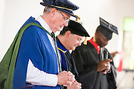 (L-R) The Rev. Dr. Timothy Quill, professor and director of International Studies at Concordia Theological Seminary, Fort Wayne, Ind., the Rev. Dr. Lawrence R. Rast, Jr., president of CTS, and Bishop Emmanuel Makala, pray at the conclusion of the graduation of 21 pastors and seven deaconesses on Saturday, March 14, 2015, at the Evangelical Lutheran Church in Tanzania – South-East of Lake Victoria Diocese's (ELCT-SELVD) Ebenezer Cathedral in Shinyanga, Tanzania. LCMS Communications/Erik M. Lunsford