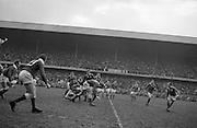 Irish Rugby Football Union, Ireland v Wales, Five Nations, Landsdowne Road, Dublin, Ireland, Saturday 7th March, 1964,.7.3.1964, 7.3.1964,..Referee- A C Luff, Rugby Football Union, ..Score- Ireland 6 - 15 Wales, ..Irish Team, ..F S Keogh, Wearing  Number 15 Irish jersey, Full Back, Bective Rangers Rugby Football Club, Dublin, Ireland,  ..P J Casey, Wearing number 14 Irish jersey, Right Wing, University College Dublin Rugby Football Club, Dublin, Ireland, .. M K Flynn, Wearing number 13 Irish jersey, Right Centre, Wanderers Rugby Football Club, Dublin, Ireland, ..J C Walsh,  Wearing number 12 Irish jersey, Left Centre, University college Cork Rugby Football Club, Cork, Ireland,..K J Houston, Wearing number 11 Irish jersey, Left Wing, Queens University Rugby Football Club, Belfast, Northern Ireland,..C M H Gibson, Wearing number 10 Irish jersey, Stand Off, Cambridge University Rugby Football Club, Cambridge, England, and, N.I.F.C, Rugby Football Club, Belfast, Northern Ireland, ..J C Kelly, Wearing number 9 Irish jersey, Scrum Half, University College Dublin Rugby Football Club, Dublin, Ireland,..P J Dwyer, Wearing number 1 Irish jersey, Forward, University College Dublin Rugby Football Club, Dublin, Ireland, ..P Lane, Wearing number 2 Irish jersey, Forward, Old Crescent Rugby Football Club, Limerick, Ireland, ..T A Moroney, Wearing number 3 Irish jersey, Forward, University College Dublin Rugby Football Club, Dublin, Ireland, ..W A Mulcahy, Wearing number 4 Irish jersey, Captain of the Irish team, Forward, Bective Rangers Rugby Football Club, Dublin, Ireland,  ..M W Leahy,  Wearing number 5 Irish jersey, Forward, University college Cork Rugby Football Club, Cork, Ireland,..E P McGuire,  Wearing number 6 Irish jersey, Forward, University college Galway Rugby Football Club, Galway, Ireland,..M G Culliton, Wearing number 8 Irish jersey, Forward, Wanderers Rugby Football Club, Dublin, Ireland, ..N A Murphy, Wearing number 7 Irish jersey, Forward, Cork Constitution Rugby