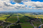 Nederland, Noord-Holland, Gemeente Purmerend, 14-06-2012; polder Wijdewormer, droogmakerij uit de 17e eeuw. Links Purmerend, Vinex wijk Weidevenne, rechts het dorp Neck. Het oorspronkelijke landschap is aangetast door de aanleg van autosnelweg A7..Wijdewormer polder, reclaimed land dating from the 17th century. The original landscape has been affected by the construction of motorway A7..luchtfoto (toeslag), aerial photo (additional fee required);.copyright foto/photo Siebe Swart