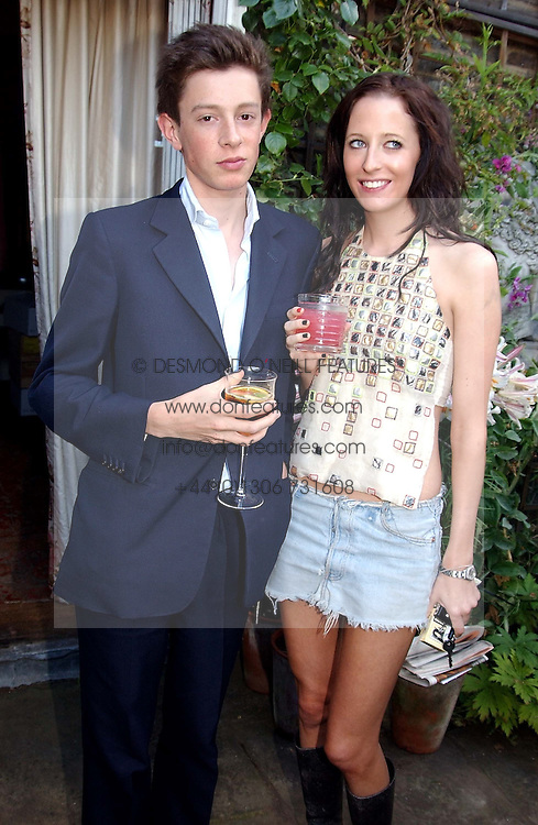 JAMES ROTHSCHILD and the HON.SOPHIA HESKETH at a Conservative Party summer garden party hosted by Lord Hesketh and held at 7 Lansdowne Road, Notting Hill, London W11 on 28th June 2004.