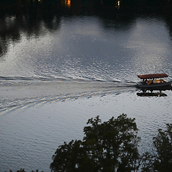 Austin, TX August 18, 2020: Texans enjoy the cool waters and scenery of Lady Bird Lake in downtown Austin on a hot August evening. Kayakers and canoeists are usually treated to a display of Mexican free tail bats winging by on their night feeding run.