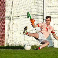Eire Og's goalie Aaron Bradley tries to save a Coolmeen penalty