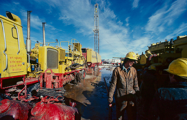 Stock photo of workers talking at a CO2 fracking site