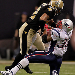 2009 November 30: New Orleans Saints safety Darren Sharper (42) puts a big hit on New England Patriots running back Kevin Faulk (33) during a 38-17 win by the New Orleans Saints over the New England Patriots at the Louisiana Superdome in New Orleans, Louisiana.