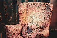 Arm chair with decorative covering and hand made cushion