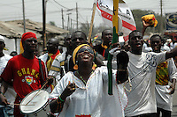 Ghana, Accra, 2007. A woman leads this joyful group toward Independence Square in Accra on March 6th, modern Ghana's 50th Anniversary.