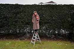 © Licensed to London News Pictures. 27/03/2013 Hatfield UK. Alison Wilding poses for photographers with her 'Untitled' work at Hatfield House, Herts. Her sculpture, installed on top of a hedge, is part of a Royal Academy exhibition that showcases six of their artists. This is the first time that the Royal Academy of Arts has collaborated with another organisation to curate an exhibition of Royal Academicians' sculpture outside the Royal Academy..Photo credit : Simon Jacobs/LNP