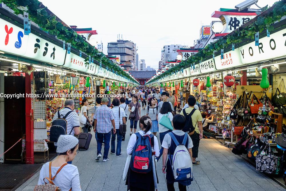 View along busy Nakamise Shopping Street at Sensoji Shrine in Asakusa district of Tokyo Japan