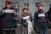 Moscow, Russia, 26/02/2012..Opposition protesters hold car stickers with the date of the Russian presidential election and slogans calling for Putin to resign. Tens of thousands of people formed a 16-kilometre [10-mile] human chain along Moscow's Garden Ring Road in the latest protest against Prime Minister Vladimir Putin and his presidential election campaign. Opposition activists estimated that they needed 34,000 people to complete the chain and symbolically encircle central Moscow.
