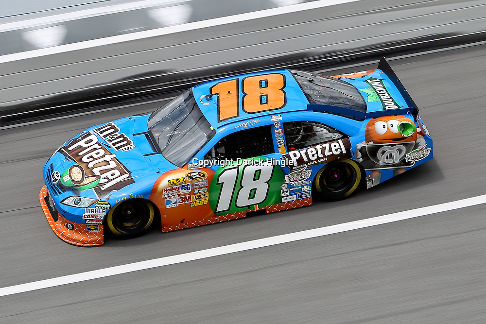 April 16, 2011; Talladega, AL, USA; NASCAR Sprint Cup Series driver Kyle Busch (18) during qualifying for the Aarons 499 at Talladega Superspeedway.   Mandatory Credit: Derick E. Hingle