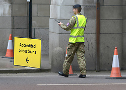 © Licensed to London News Pictures. 18/07/2012. Westminster, UK A soldier at Admiralty Arch. Soldiers, police and security contractors perform security checks around Olympic sites in Westminster today, 18th July 2012. Photo credit : Stephen Simpson/LNP