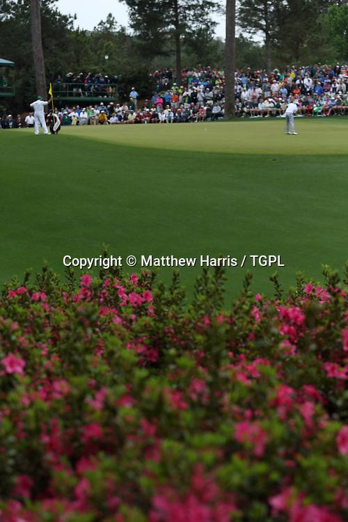 Adam SCOTT (AUS) on 10th green during fourth round,US Masters 2013,Augusta National,Augusta,Georgia,USA.