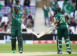 Pakistan's Fakhar Zaman (left) celebrates a 4 with teammate Imam-ul-Haq during the ICC Cricket World Cup group stage match at Trent Bridge, Nottingham.