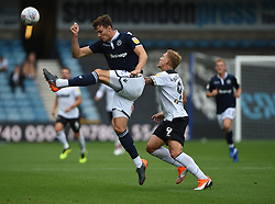 Derby County's Martyn Waghorne and Millwall's Jake Cooper battle for the ball