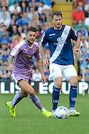 Jonathan Grounds plays the ball away from Michael Hector during the Sky Bet Championship match between Birmingham City and Reading at St Andrews, Birmingham, England on 8 August 2015. Photo by Alan Franklin.