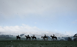 LNP Weekly Highlights 28/03/14  © Licensed to London News Pictures. 22/03/2014<br /> <br /> Middleham, North Yorkshire<br /> <br /> Race horses exercise at first light on the horse racing gallops in Middleham, North Yorkshire. Race horses have been trained in Middleham for over 200 years using the extensive gallops on the high moor. There are currently 15 stables based around the small Yorkshire village.<br /> <br /> Photo credit : Ian Forsyth/LNP