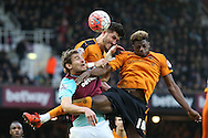 Nikica Jelavic of West Ham United (l) is challenged by Dominic Iorfa ® of Wolverhampton Wanderers and Danny Batth of Wolverhampton Wanderers (c).The Emirates FA cup, 3rd round match, West Ham Utd v Wolverhampton Wanderers at the Boleyn Ground, Upton Park  in London on Saturday 9th January 2016.<br /> pic by John Patrick Fletcher, Andrew Orchard sports photography.