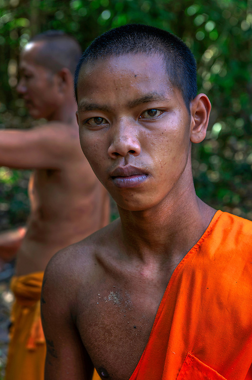 Cambodian buddhist monk labouring, Angkor Thom, Siem Reap, Cambodia