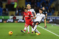 Reece James of Rotherham ® challenges Cardiff's Kim Bo-Kyung. Skybet football league championship match, Cardiff city v Rotherham Utd at the Cardiff city stadium in Cardiff, South Wales on Saturday 6th December 2014<br /> pic by Andrew Orchard, Andrew Orchard sports photography.