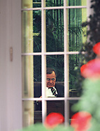 President  H.W Bush reads at  the Resolute desk in the Oval Office.<br />Photo by Dennis Brack