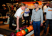 The Prince of Orange and Princess Máxima bowling during NLdoet with homeless shelter location of the Catharijne House in Utrecht. NLdoet is the largest voluntary action of the country, organized by the Orange Fund<br /> © Oranjefonds - Bart Homburg