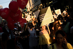 """July 29, 2017 - Istanbul, Turkey - July 29, 2017 - Istanbul, Turkey - Hundreds of women marched in Istanbul on July 29 to protest against violence and animosity they face from men demanding they dress more conservatively. The march, dubbed """"Don't Mess With My Outfit,"""" started in the Kadıköy district on the Asian side of the city. Women chanted slogans and carried denim shorts on hangers as examples of the type of clothing some men say they find unacceptable. """"We will not obey, be silenced, be afraid. We will win through resistance,"""" the crowds chanted, holding up posters and LGBT rainbow flags. Protesters say there has been an increase in the number of verbal and physical attacks against women for their choice of clothing in Turkey in recent years. Since the ruling Justice and Development Party (AKP) took office nearly 15 years ago, restrictions on wearing the headscarf have been eased and more women in the country have chosen to wear it. The march also saw several women protesting against the criticism they have faced for choosing to wear headscarves. (Credit Image: © Nazim Serhat Firat/Depo Photos via ZUMA Wire)"""