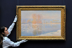 """© Licensed to London News Pictures. 06/10/2017. London, UK. A technician presents """"Les Glaçons, Bennecourt"""", 1893, by Claude Monet at a preview at Sotheby's in New Bond Street of contemporary, impressionist and modern art works to be auctioned in New York in November 2017 Photo credit : Stephen Chung/LNP"""