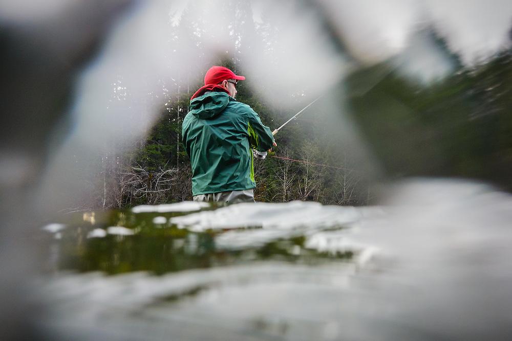 Gary Rawson fishing for winter steelhead. Nimpkish River, North Vancouver Island