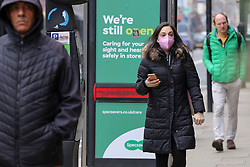 © Licensed to London News Pictures. 02/03/2021. London, UK. A woman wearing a protective face covering in north London.  The number of Covid-19 infection rate and deaths have dropped more than a quarter within a week as the effect of lockdown restrictions and vaccine rollout is making an impact. Six cases of the P1 variant have been identified in people who recently returned from Brazil. Photo credit: Dinendra Haria/LNP