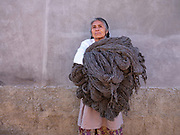 A Zapotec woman carries skeins of natural Churro sheep wool in the weaving village of Teotitlan del Valle in Oaxaca, Mexico on 27 November 2018. Weaving blankets has been part of their heritage for thousands of years, the knowledge has been passed down from generation to generation