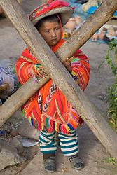 Pentecostes Festival held annually in May, Ollantaytambo, Peru, South America; boy standing behind