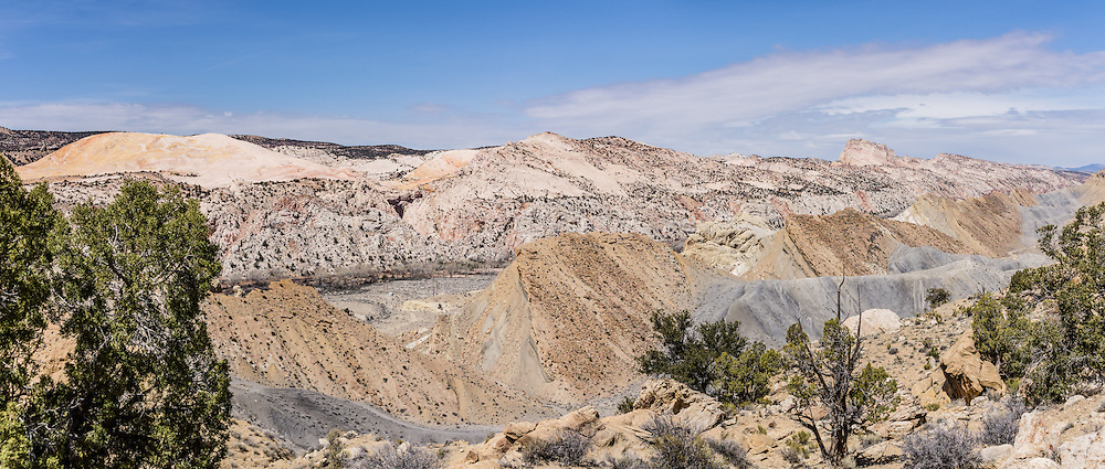 Hike the Cockscomb, a striking monocline (geologic fold) in Grand Staircase-Escalante National Monument, Utah, USA. At left is Yellow Rock above Hackberry Canyon. The Cockscomb is the northern extension of the East Kaibab Monocline, a major feature of the Colorado Plateau stretching over 100 miles north from the Grand Canyon. Directions to the easiest Cockscomb ascent: On Highway 89, drive 10 miles west of Big Water. Between mileposts 17-18 on H89, turn north on Cottonwood Canyon Road (#400) and drive 12 miles to where a side road turns east over the Cockscomb (a quarter mile south of Hackberry Canyon parking lot). Park at the bottom of the steep road and walk 3 miles round trip to the crest, gaining 950 feet. The panorama was stitched from 2 overlapping photos.